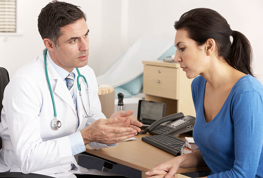 patient speaking with a doctor