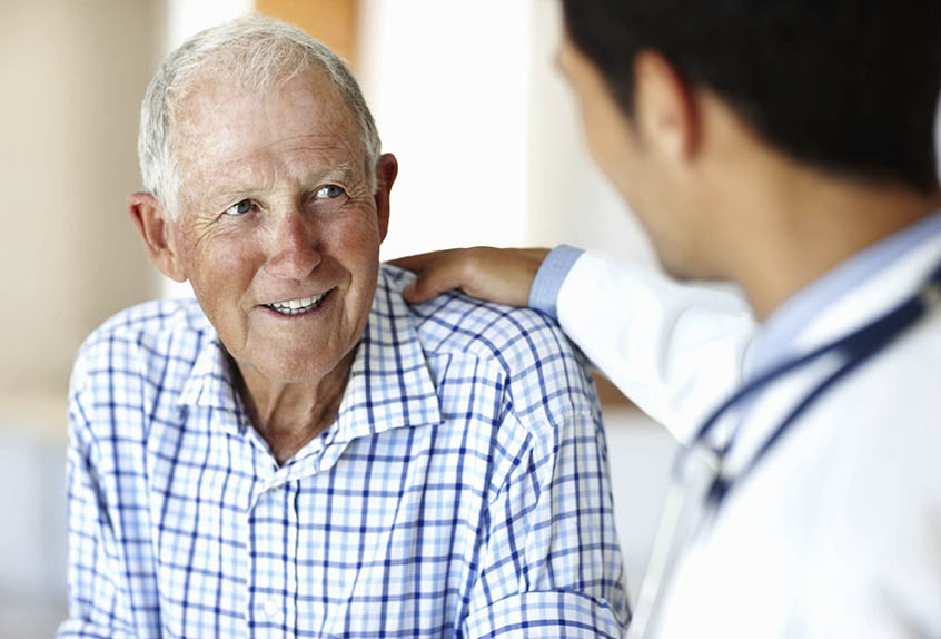 older man speaking with his doctor