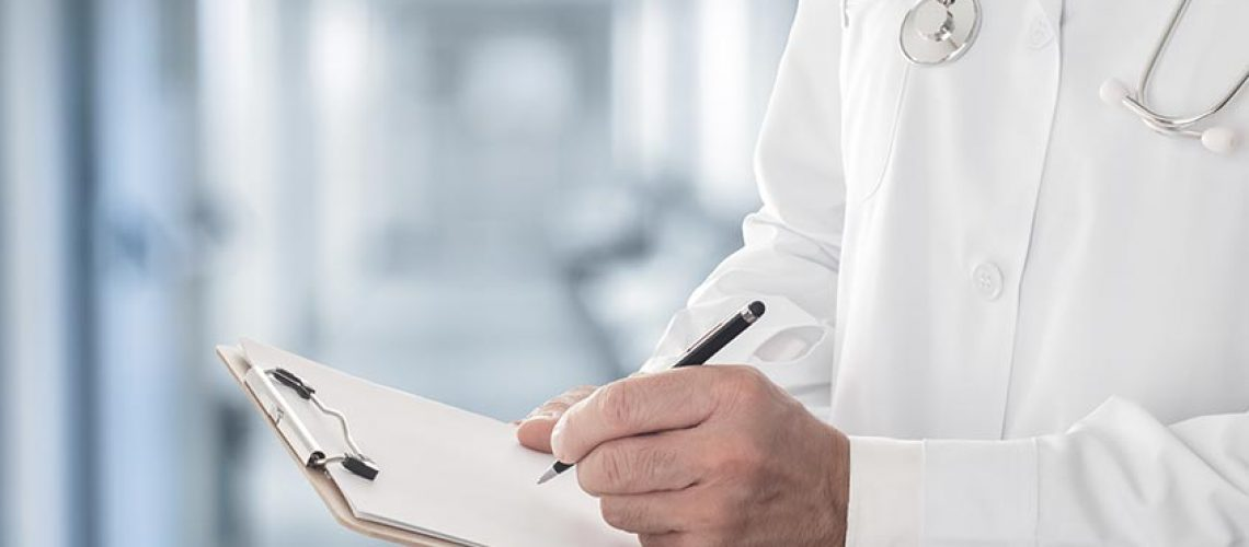 doctor using a clipboard