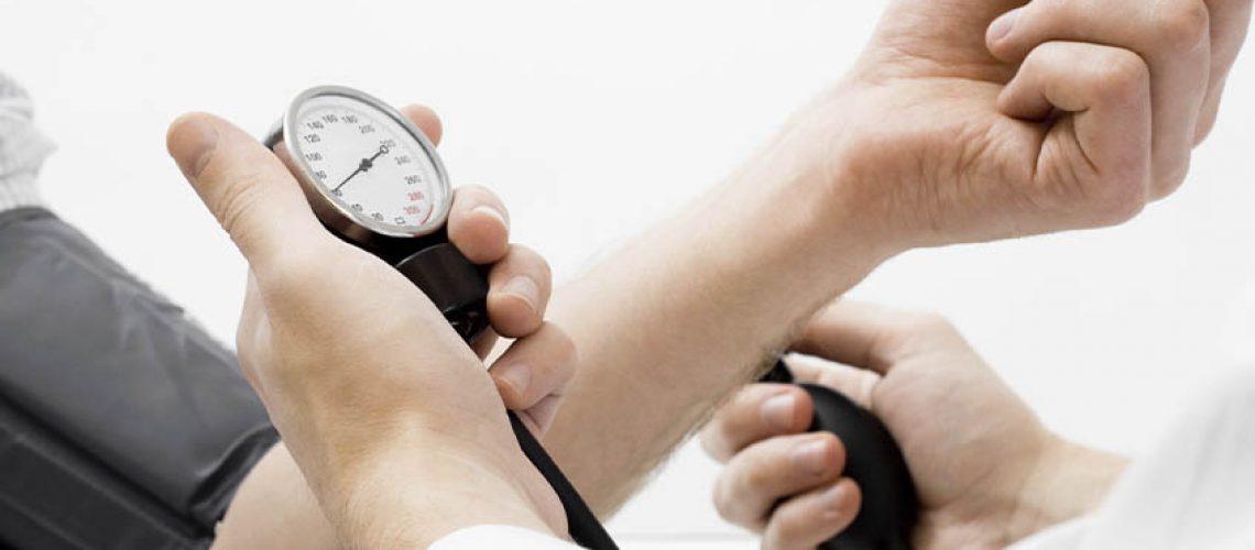 doctor taking patient's pulse